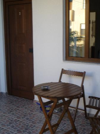 Triton Apartments: small private front patio