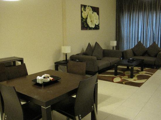 Dunes Hotel Apartments Barsha : living room with dining table