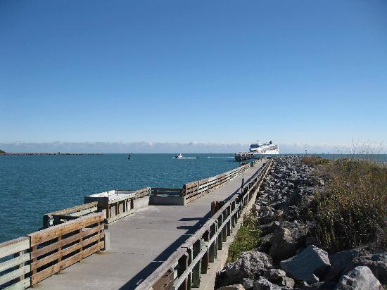 Jetty Park Campground: Fishing pier/jetty - cruise ship on its way back to port