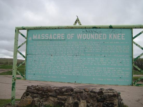 Wounded Knee Massacre Monument: A sign about the Massacre