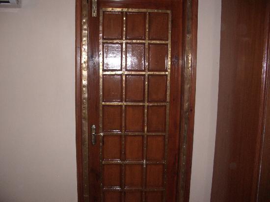 Virasat Haveli: Door to the bathroom, with copper fittings