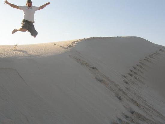 MOSAIC Lagoon Lodge: My husband enjoying the sand dunes at the beach
