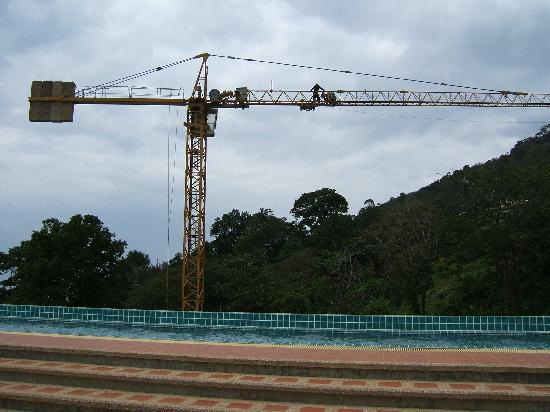 The Bay Cliff: cranes over pool with no loungers to use ! bad
