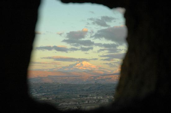 Argos in Cappadocia: Sunset reflecting upon Mount Erciyes as seen from inside a Fairy Chimney just 1 minute walk to t