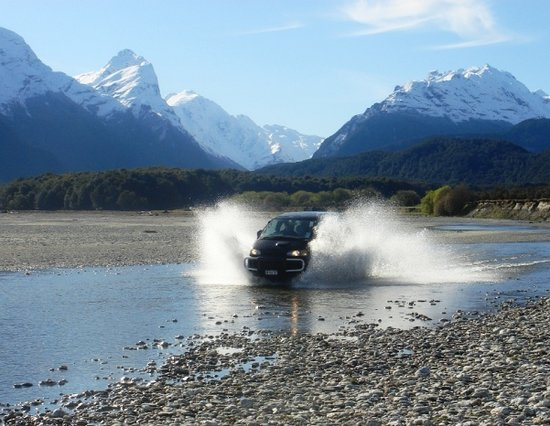 Nomad Safaris: Our 4WD vehicle crossing the Dart River, location of Isengard