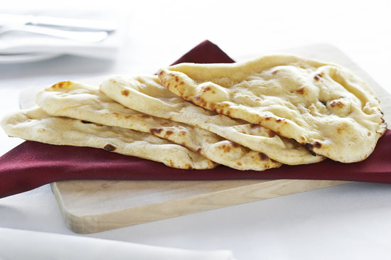 Punjab Indian Restaurant : Naan cooked in our charcoal fired Tandoor Oven