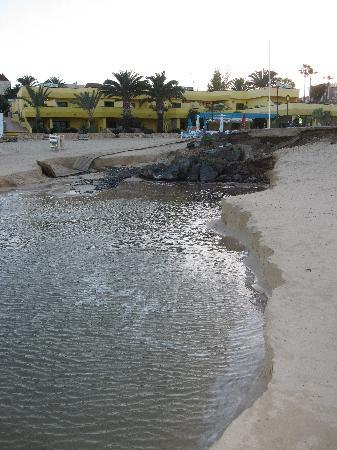 Caleta Playa Apartments: Section of beach washed away by flood water.