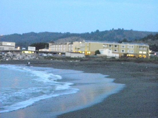 Holiday Inn Express Hotel & Suites Pacifica: View of the hotel (far right) from the beach