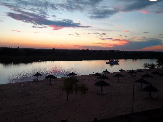 Lambare, Paraguay: sunset-view from the room to the river