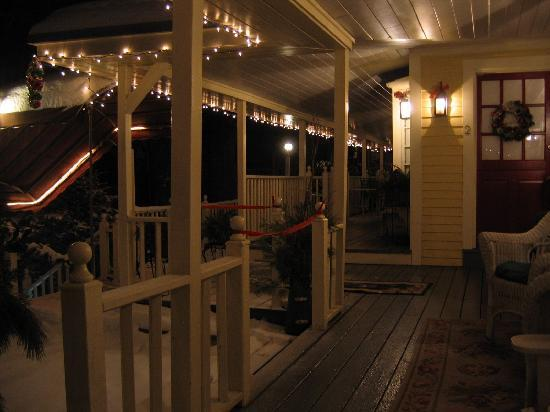 Eastman Inn: Porch Lit up on a Snowy Night