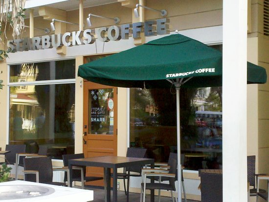 Starbucks front entrance with tables out front