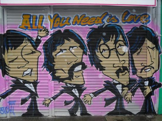 some cool graffiti picture of the beatles fab four taxi tour