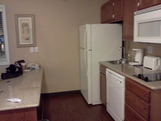 GrandStay Hotel & Suites Perham, MN: The kitchen.  It has utensils, pots and pans, coffeemaker, toaster, and a dishwasher.