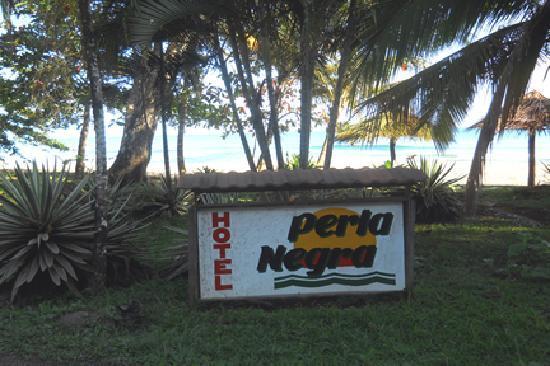 Hotel Perla Negra sign