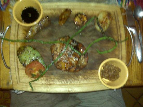 Imagine Restaurant and Bar: my entree -- that's pineapple atop chicken in the middle -- complete with stained cutting board