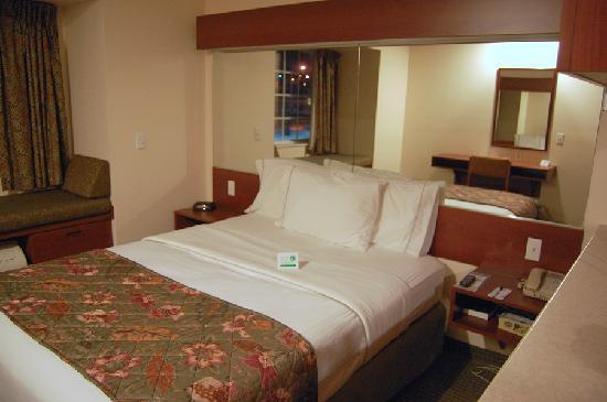 Microtel Inn & Suites by Wyndham Bellevue : Sleeping area inside a king suite...Microtel, Bellevue NE