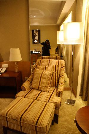 Eurasia International Hotel: armchair next to bed