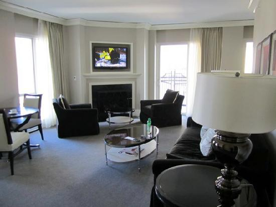 Waldorf Astoria Chicago: one view of the living room and fireplace