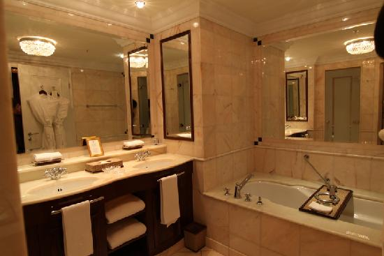 The Ritz Carlton  Berlin  Spacious bathroom with separate shower and bath. Spacious bathroom with separate shower and bath   Picture of The