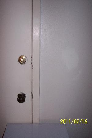 Days Inn - Holly Springs: Refrigerator blocked the door to the next room.  Poor paint job.  Poor repair and paint on the w