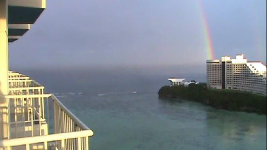 The Westin Resort Guam: Balcony view of another hotel and rainbow.  (uploaded because everybody loves rainbows)