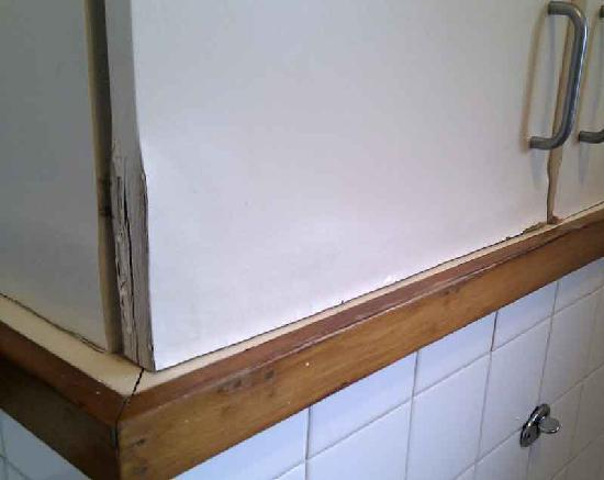 City Towers: rotten woodwork in the bathroom