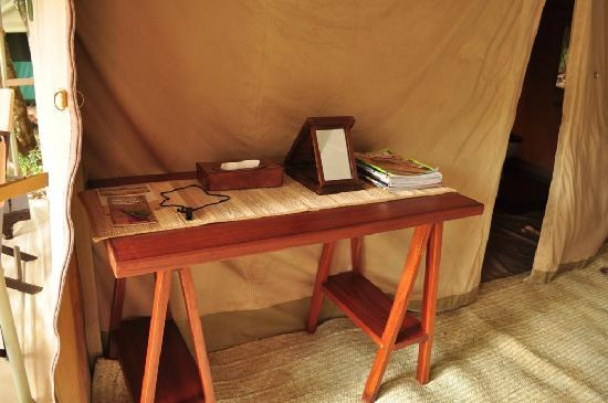 Nairobi Tented Camp: A table with tissues, mirror, magazines and a whistle