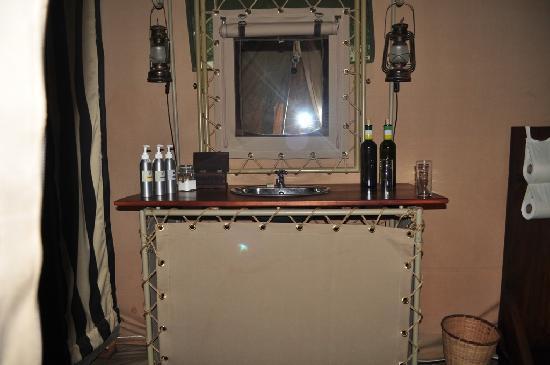 Nairobi Tented Camp: wash basin with a mirror, shampoo and soap
