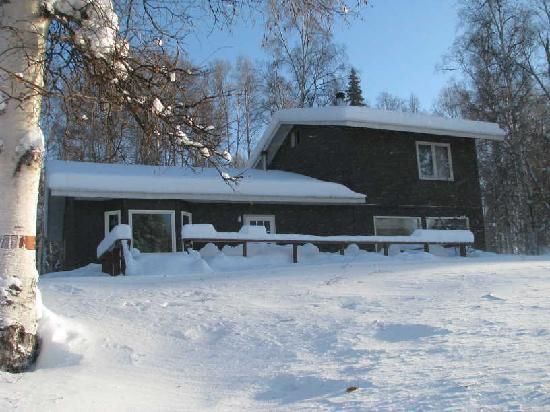 Riverbend Log Cabins & Cottage Rentals: Front View of House from the river bank