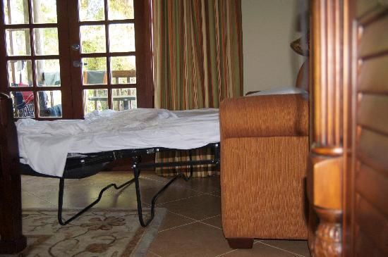 Beaches Negril Resort & Spa : The pull-out bed of a Grand Luxe room. Notice how the bed slopes from head to foot.