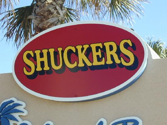 Shucker's : Look for this sign when arriving at your Beach Side  Restaurant and Tiki Bar.   .