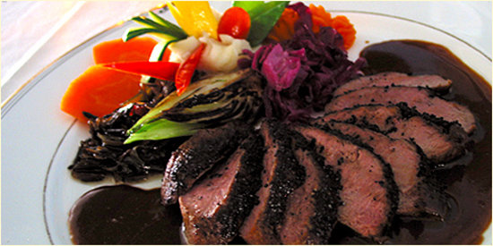 Restaurant Bouchard: Duck breast sautéed with a Coffee Crust, Finished with a Brandy Balsamic Sauce