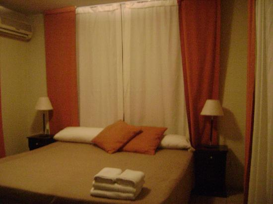 Exclusive Apart Hotel Mendoza: Dormitorio