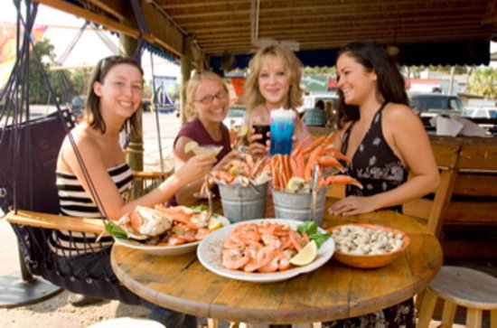 Folly Beach Crab Shack: The friendly staff, relaxed atmosphere, and delicious food attract locals and visitors alike.