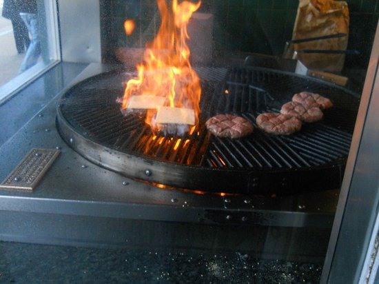 Hamburgers grilling in the window of Hamburgers