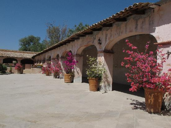 Hacienda Las Trancas: patio and stables