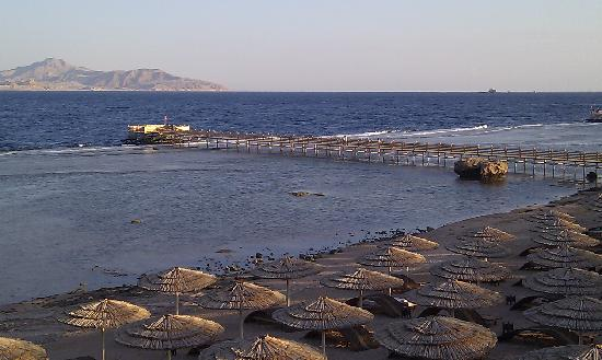 Cleopatra Luxury Resort Sharm El Sheikh: View from the terrace over the beach & jetty towards Tiran Island