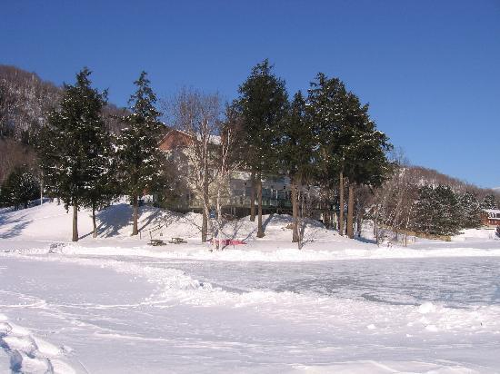 Auberge du Coq de Montagne : A view of the hotel from the frozen lake