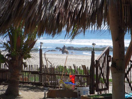 Los Suenos: View from the bar to passing horseman and friend