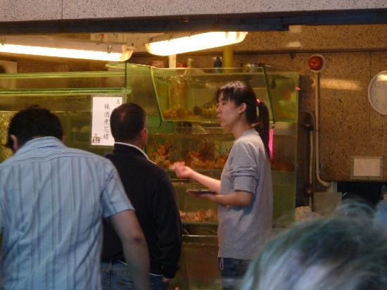 Tai Yuen Seafood Restaurant: Karen, the restaurant manager halping a client to choose...