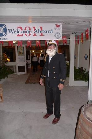 The Meridian Club Turks & Caicos: The club manager as Capt. Smith greets partygoers