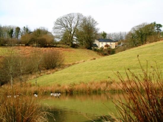 Wheddon Cross, UK: house and lake