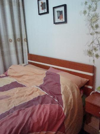 Guangdong Guest House: Bed