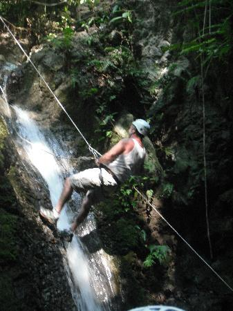 El Remanso Lodge: My husband Craig descending the waterfall