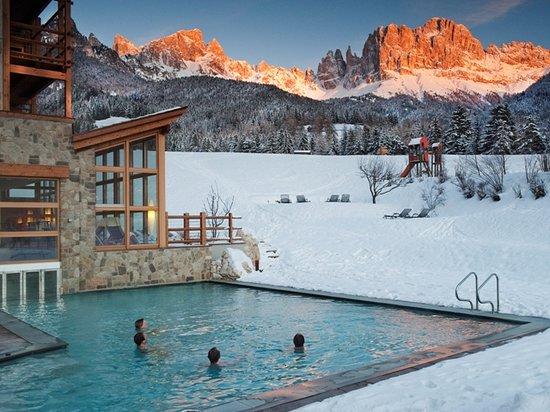 Tiers, Italy: im 30° warmen Wasser unterm Rosengarten baden