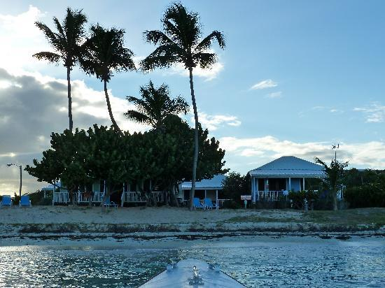 Dutchman's Bay Cottages: A view of the cottages from the water at dusk