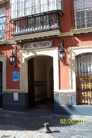 Street-level view of Hotel Maestranza's exterior