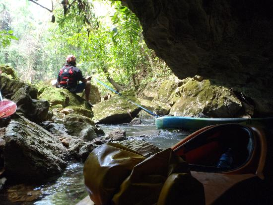 Maya Guide Adventures: Lowering kayaks into the cave