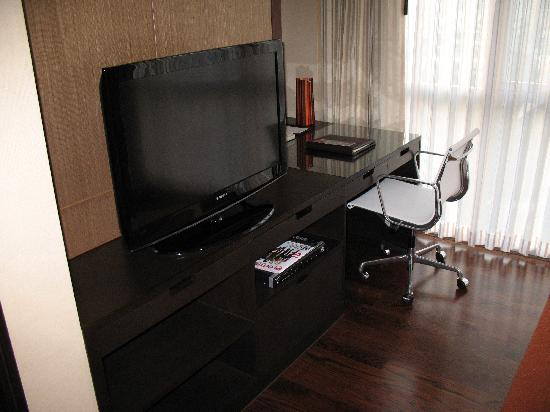 work desk and television in living room Picture of Sathorn Vista