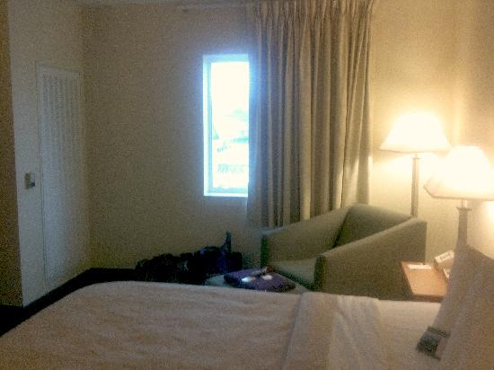 Quality Inn: View toward window and easy chair
